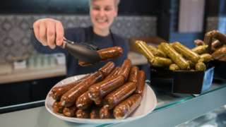 Sarah Pollinger poses in her vegan butchery Vetzgerei, where vegan sausage products are displayed