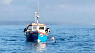 Fishing vessel alongside Nathan Rogers