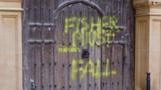 Spray paint on the Gate of Honour at Gonville & Caius College