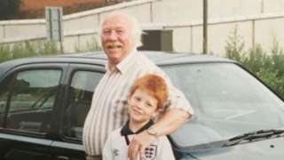 Derek Levers and his grandson