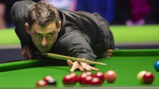 Ronnie O'Sullivan plays a shot