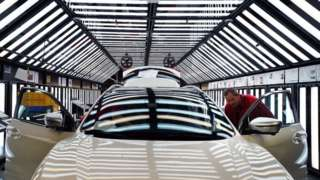 "Workers on the production line at Nissan""s factory in Sunderland"