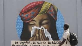 Вуличні графіті в Дакарі просять людей прикривати рот, коли вони чхають