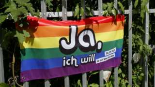 Rainbow flag in the Swiss capital Bern urging people to vote yes to same-sex marriage
