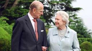 Britain's Queen Elizabeth II and her husband, the Duke of Edinburgh walk at Broadlands, Hampshire in 2007
