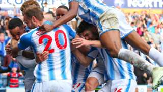 Huddersfield players celebrate with goalscorer Tom Ince
