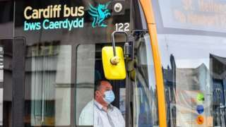 A bus driver in Cardiff wearing a face mask