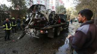 Authorities remove wreckage from the scene of an attack in Kabul