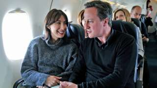 David Cameron and his wife Samantha Cameron on a plane in 2010
