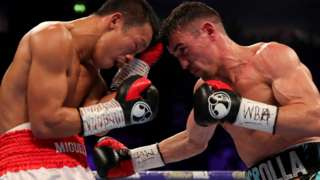 Anthony Crolla hits Daud Yordan with a right hand