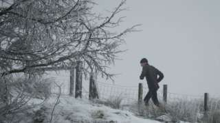 A fell runner in the snow