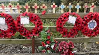 Poppy wreaths laid at the memorial at the site of the Narrow Water bombing