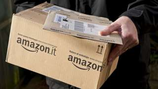 Man holds Amazon delivery