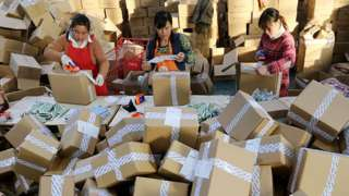 Women packing parcels