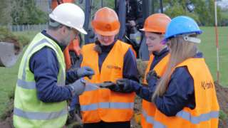 Jonny McNee with Foyle College students at dig site
