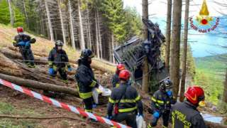 Rescuers at the scene of the accident on Mount Mottarone on 23 May