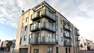 Apartment block Millennium Plaza in Cheltenham