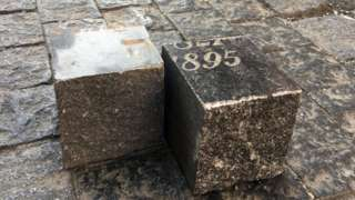 Prague cobblestones made of gravestones cut into squares