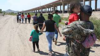 Central American migrants walk into US territory after crossing the Rio Grande under the international bridge in the border city of Ciudad Juarez, in the state of Chihuahua, Mexico, 11 June 2019. Foreign Minister Marcelo Ebrard said that the Mexican government will achieve a reduction in the flow immigration demanded by the U