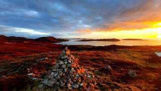 Sunset over the hamlet of Altandhu and the summer isles.