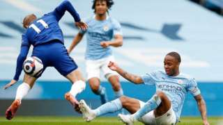 Manchester City's Raheem Sterling makes a challenge