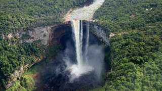 A pilot flies over the iconic Kaieteur Falls (The single largest Freefall waterfall in the world with a drop of 741 feet) in the Guyana Hinterland on day 13 of an official visit to the Caribbean on December 3, 2016 in Surama, Guyana.