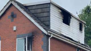 Police said at least one person was in hospital after jumping from a first floor window
