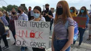 Students holding placard calling for grades to be unlocked