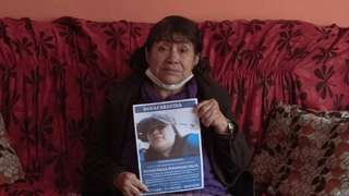 Teresa Salas Carrasco (67) carries a photo of her daughter Alison Fernandez (30), who on the morning of August 13th went out to the local market and did not return home.