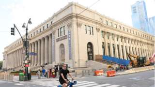 A new hall of Penn Station located in the Farley Post Office building opens on 1 January