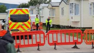 Police were seen outside a caravan on the site