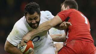 Billy Vunipola is tackled by Sam Warburton