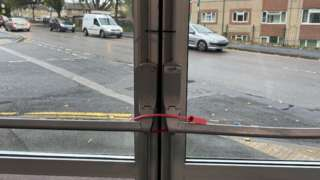 Fire exit being closed shut with cable ties