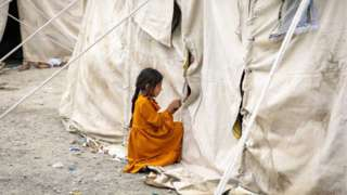An Afghan child who fled due to the fighting between Taliban and Afghan security forces from northern provinces plays near her temporary shelter in a public park in Kabul, Afghanistan, 14 August (issued 15 August).