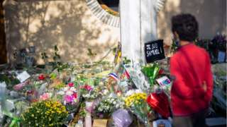 Flowers at a vigil for Mr Paty in Paris, France