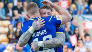 Josh Charnley celebrates one of his two tries against Toronto