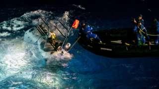 The DSV Limiting Factor submersible (left) prepares for a dive