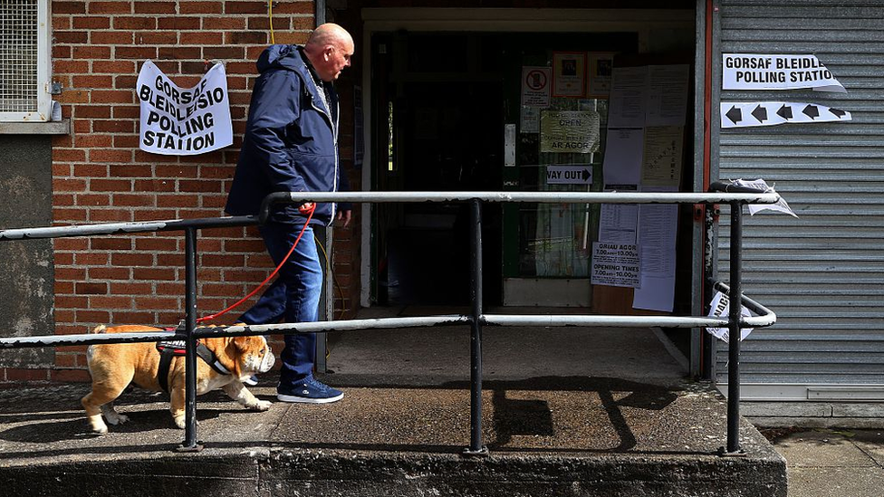 A man without a dog outside a polling station in Wales