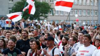 People take part in a rally to protest against presidential election results and demand from state-run media objective reporting on the situation in the country, outside the building of Belarusian National State TV and Radio Company in Minsk, Belarus August 15, 2020