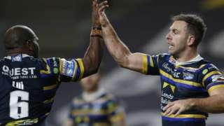Leeds Rhinos' Luke Gale celebrates scoring their second try with Rob Lui
