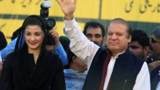 "Nawaz Sharif (R), former Prime Minister and leader of Pakistan Muslim League, gestures to supporters as his daughter Maryam Nawaz looks on during party""s workers convention in Islamabad, Pakistan 4 June 2018."