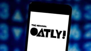 Oatly logo displayed on a smartphone