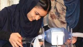 """An """"Afghan Dreamer"""" is seen assembling a respirator"""