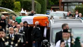Mourners carry Bobby Storey coffin ahead of his funeral in west Belfast