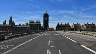 A deserted Westminster Bridge is pictured looking north