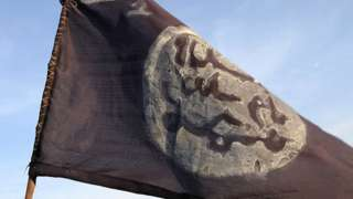 A Boko Haram flag in an area in Nigeria deserted by the militants after an offensive by Chadian soldiers - 2015
