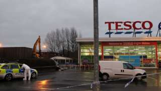 Police at the scene of a theft of cash machines at Tesco Extra in Antrim