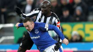 Wayne Rooney and Mohamed Diame challenge for the ball