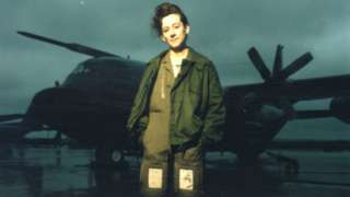 Julie in front of a plane
