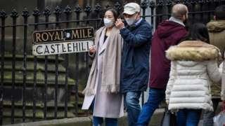 Tourists in masks in Edinburgh